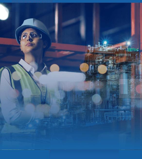 industrial worker overlooking an industrial building structure