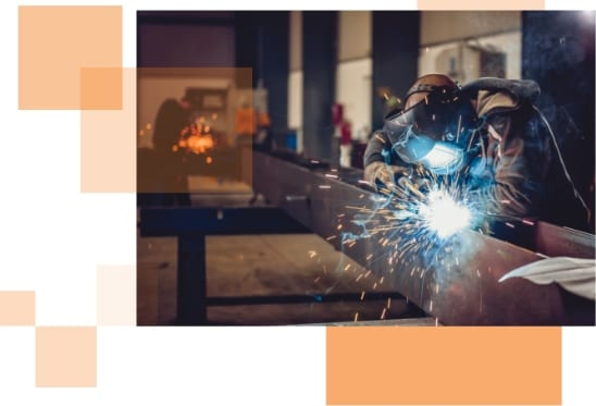 Person welding in an industrial setting