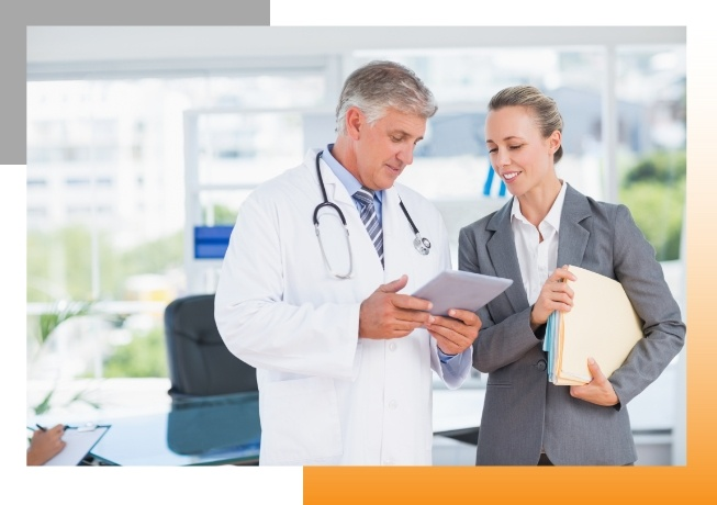 Marketer discussing marketing strategy with doctor